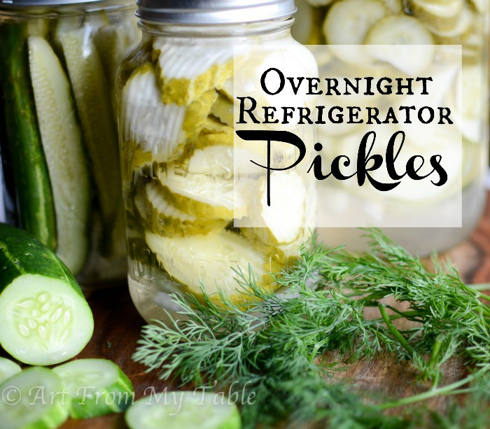 Jars of overnight refrigerator pickles. Fresh cucumbers and fresh dill in front of the jars.