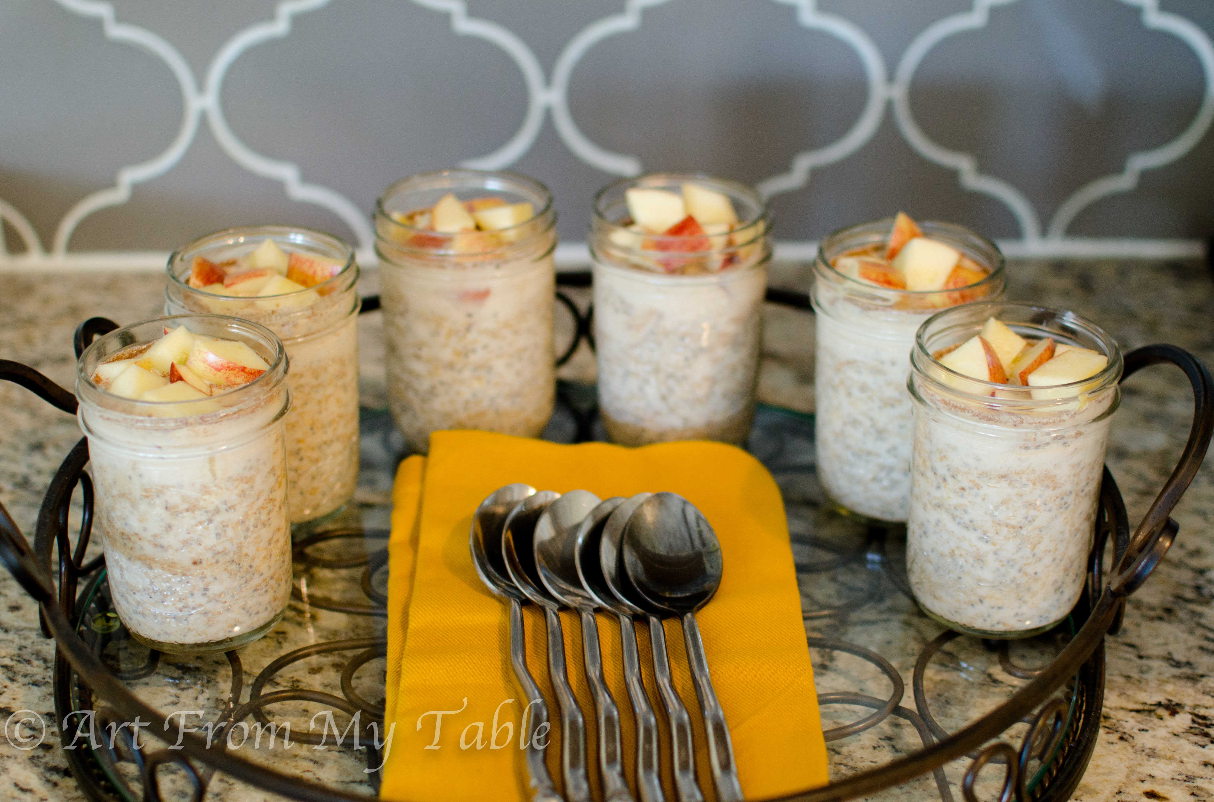 Tray of mason jars filled with Overnight oats.
