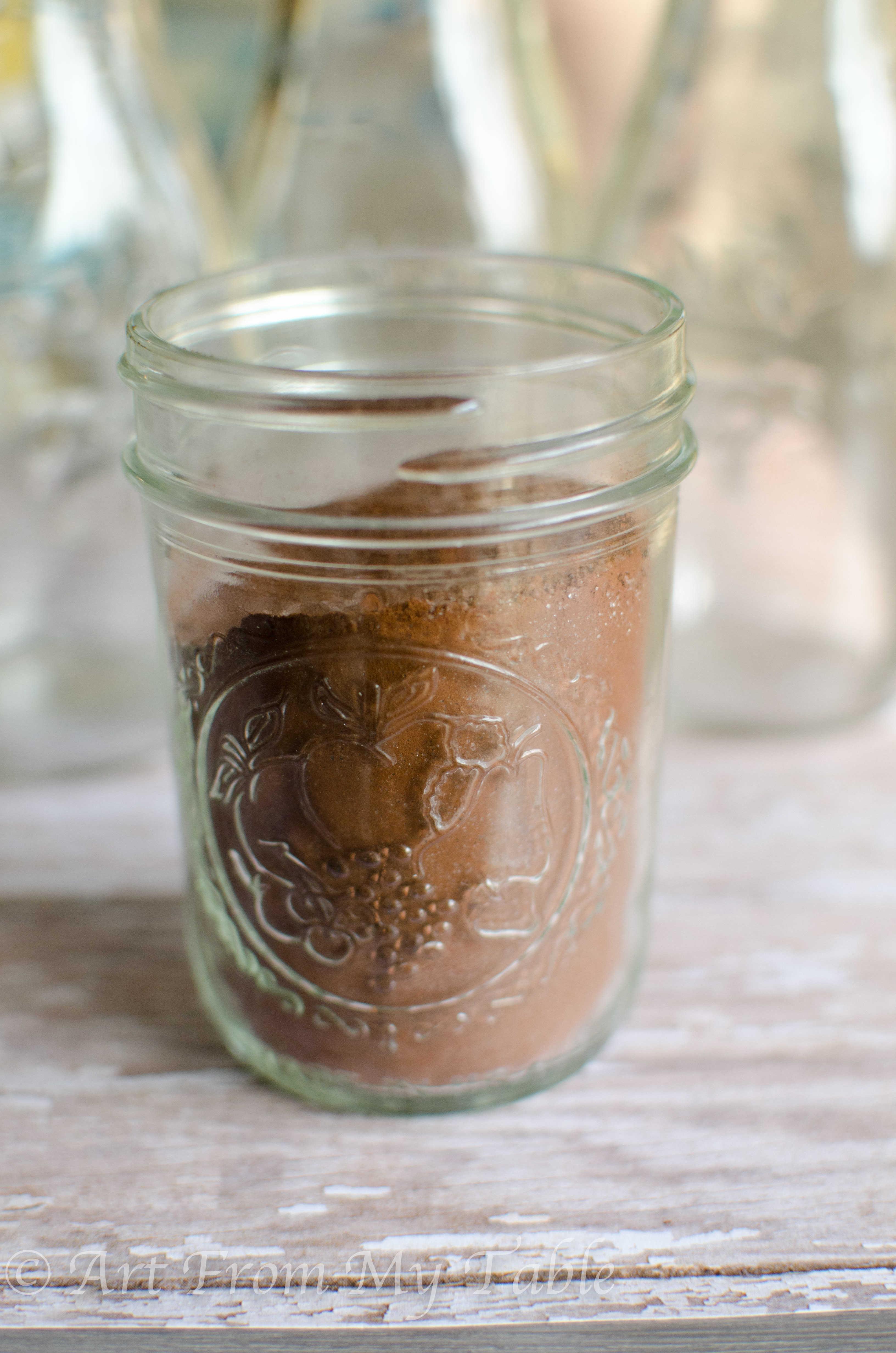 Jar with chocolate milk mix inside.