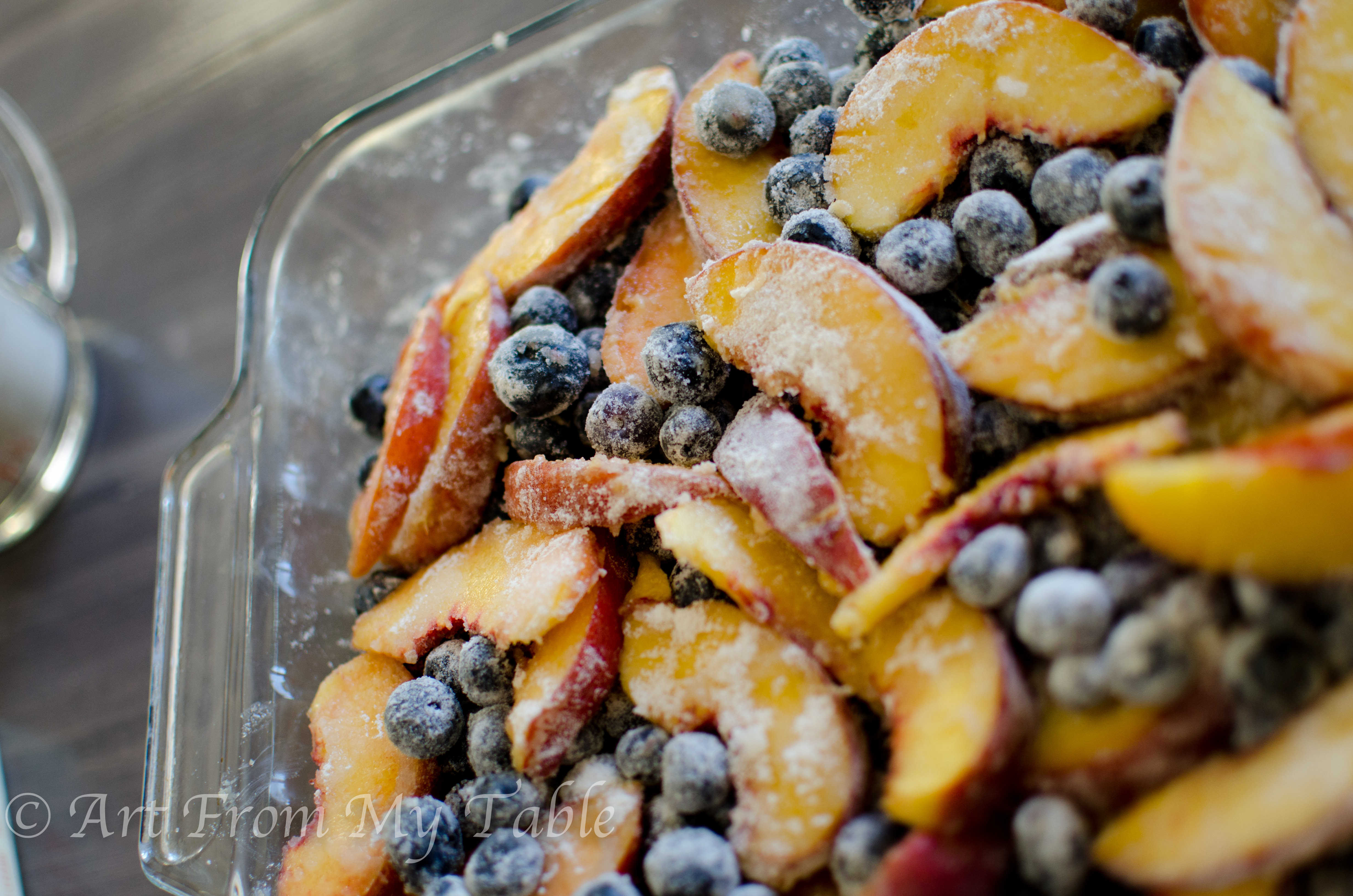 Filling for blueberry peach crisp mixed together.