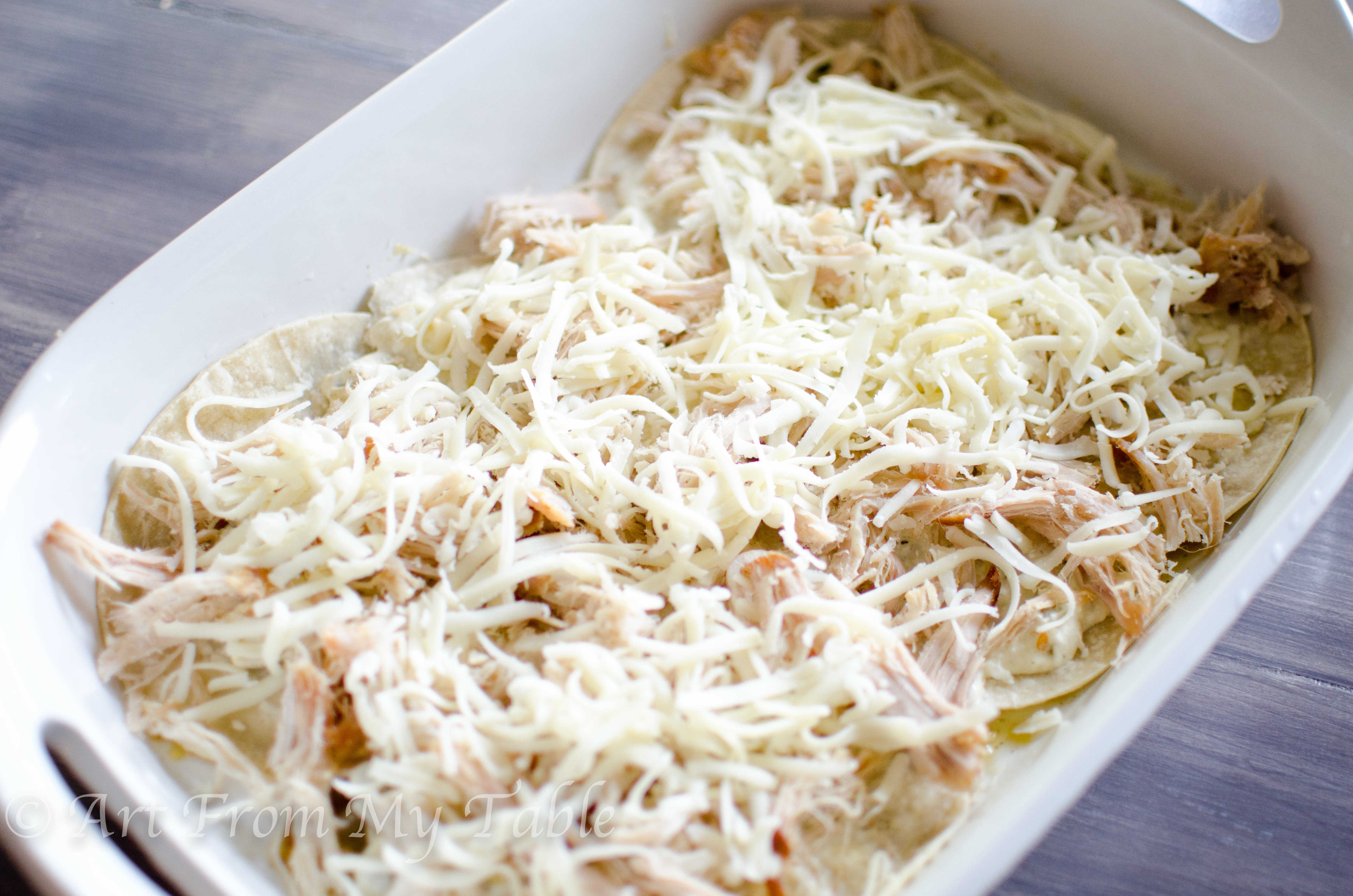 layer of cheese added to the carnitas casserole verde