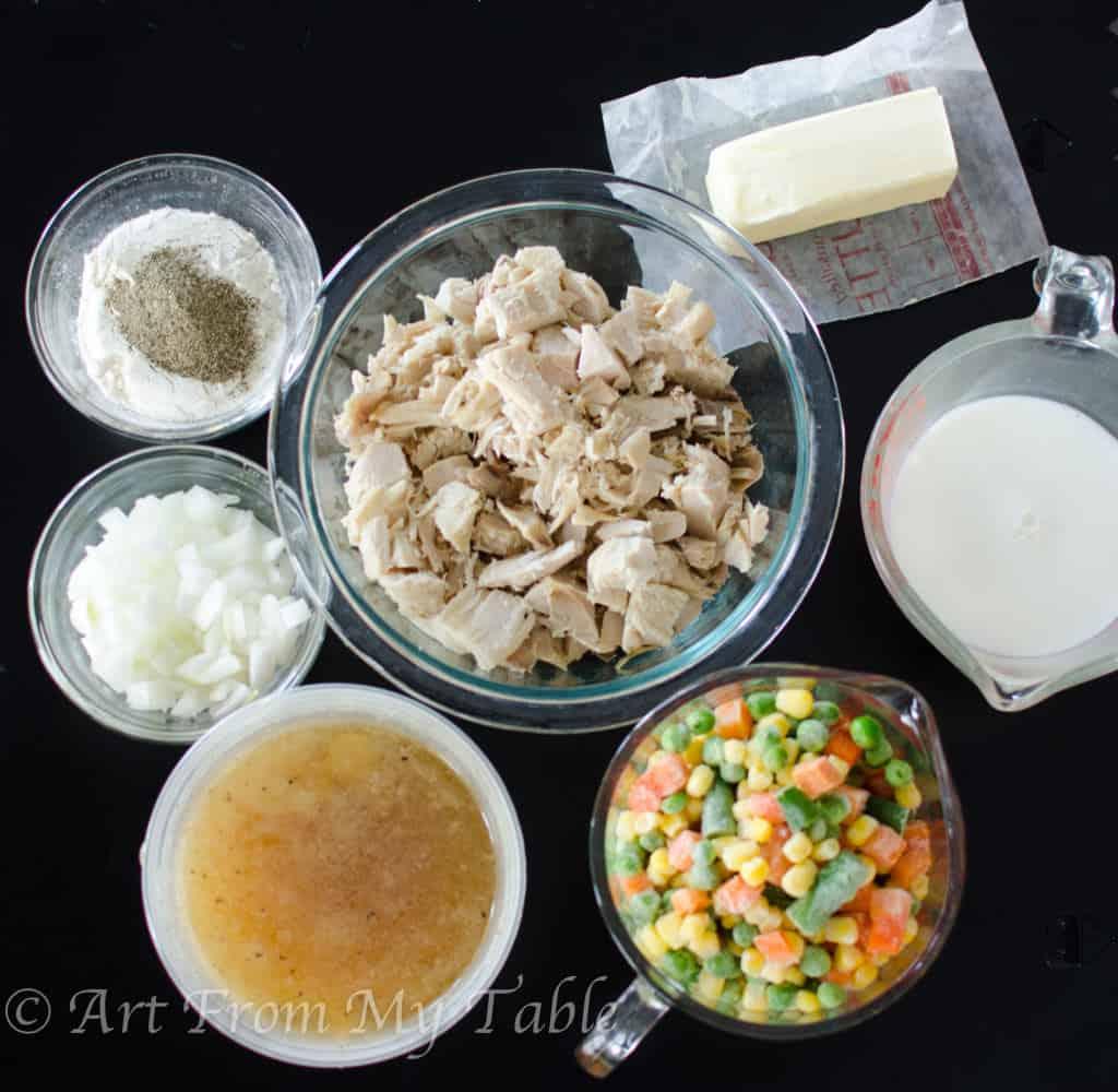 ingredients for turkey pot pie - turkey, butter, milk, frozen vegetables, broth, onion, salt, pepper and flour