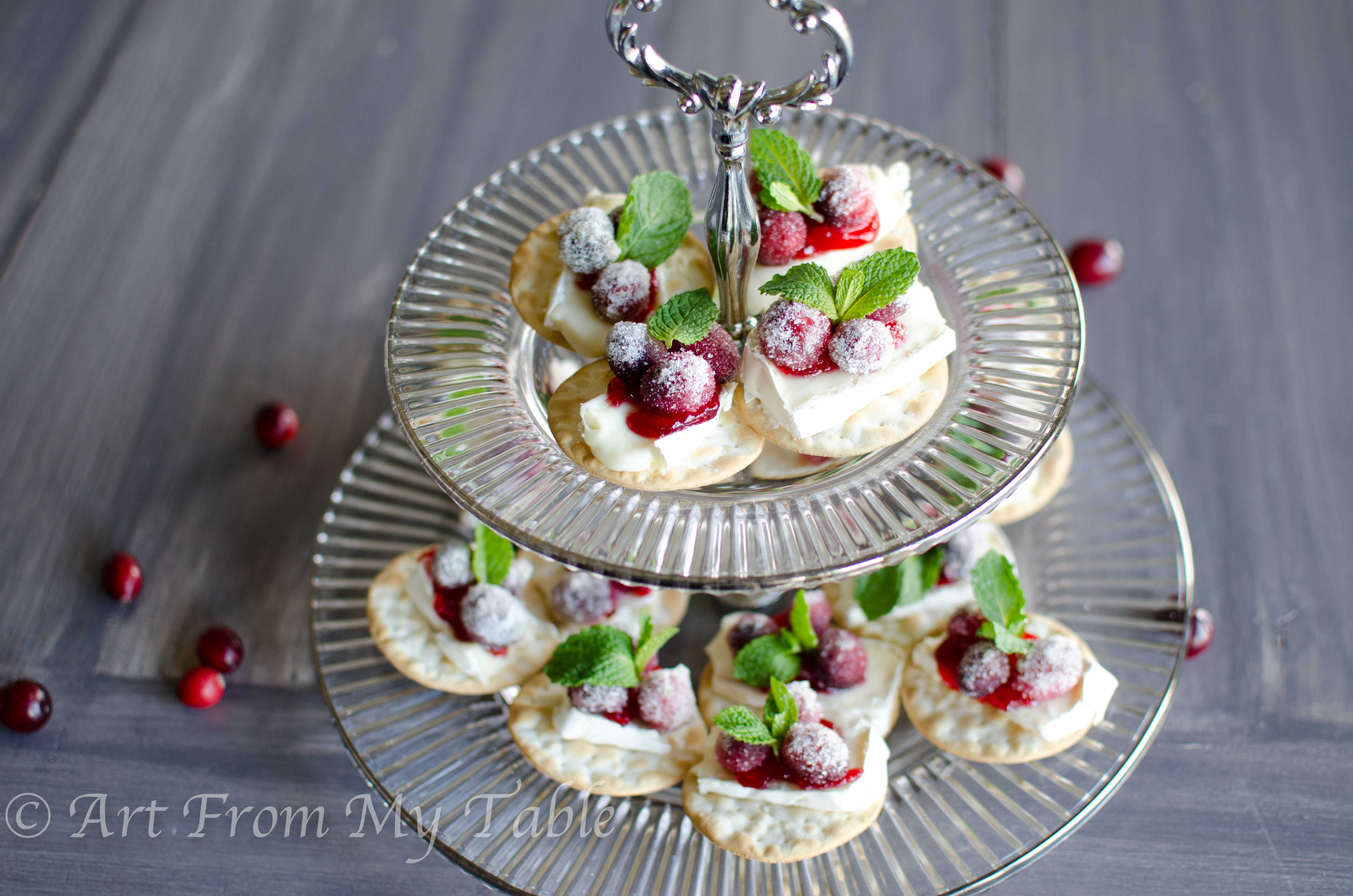 Cranberry brie bites on a tiered tray.