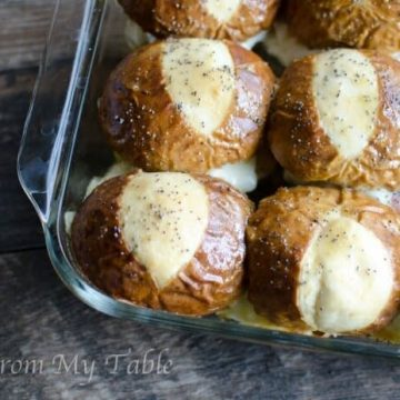 pan of baked ham and cheese soft pretzel sliders