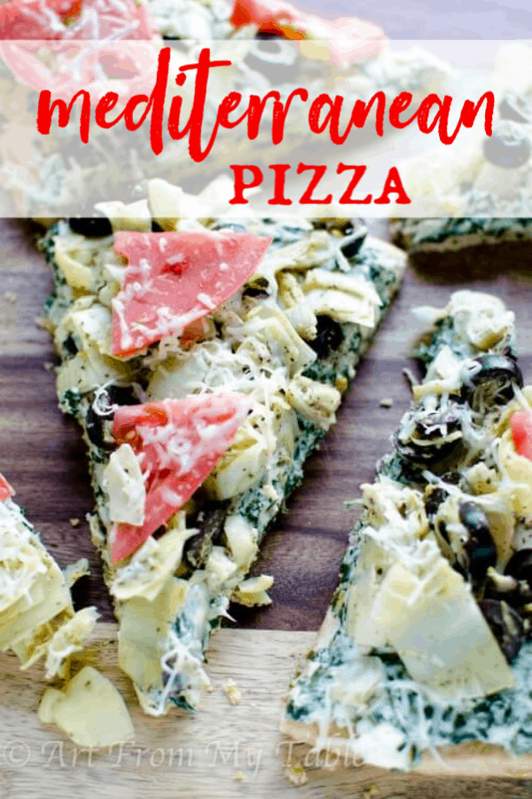 Make it a meal or an appetizer, either way this Mediterranean style pizza will be loved by all! Spinach, Artichoke hearts, tomatoes, and creamy cheese sauce, you can't stop at just one slice! #artfrommytable #pizza #mediterranean via @artfrommytable