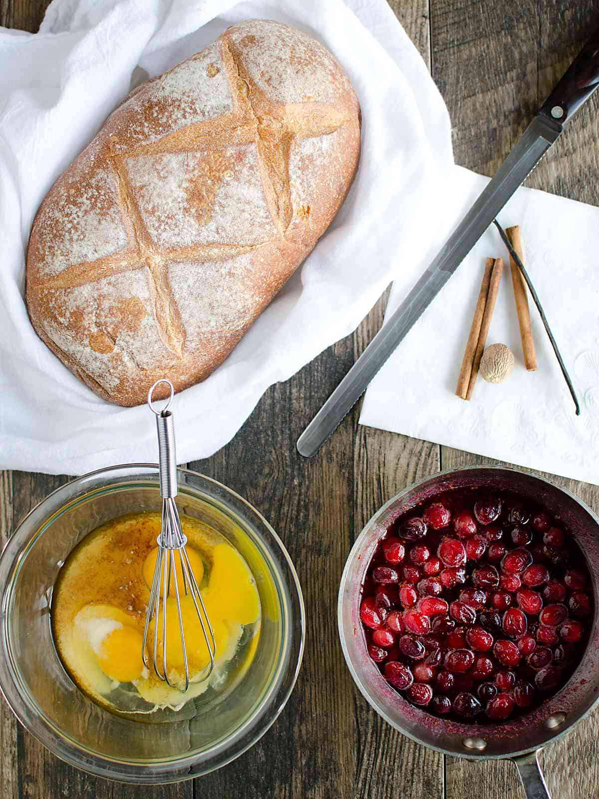 artisan bread, bowl with cracked eggs and egg nog, pan of cranberry syrup.