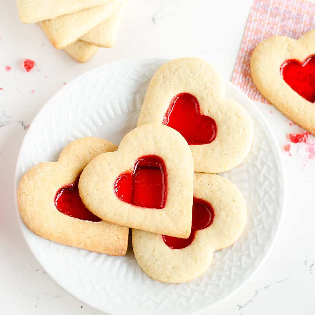 plate of Valentine's Day sugar cookies that reveal secret messages. heart shaped, with a red 'stained glass' center