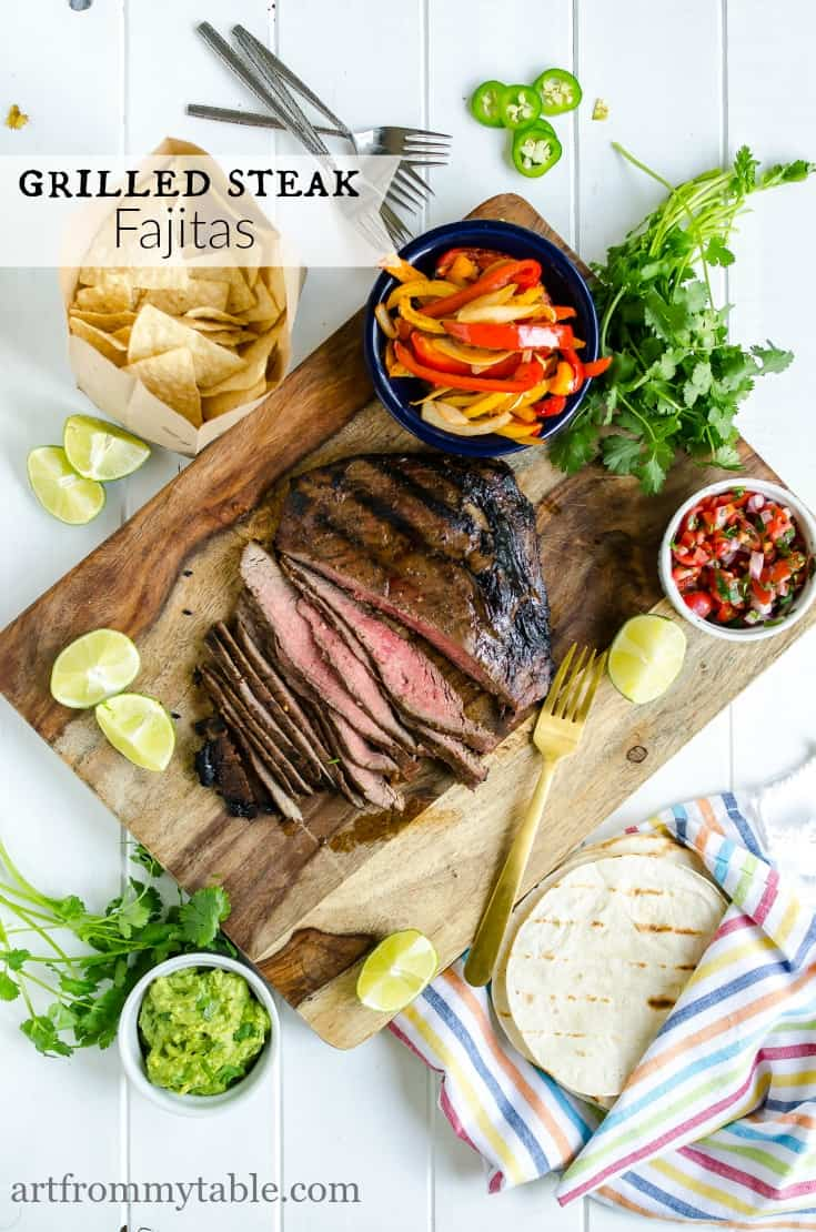 This is the best way to make Steak Fajitas! They're loaded with flavor, topped with crisp peppers and onions and all the fajita fixin's. Perfect for Summer time grilling! Make ahead and freezer instructions included. #Dinner #maindish #grilling #grillingrecipe #summer #mexican #freezermeal #dinnerideas #easyweeknightmeal via @artfrommytable