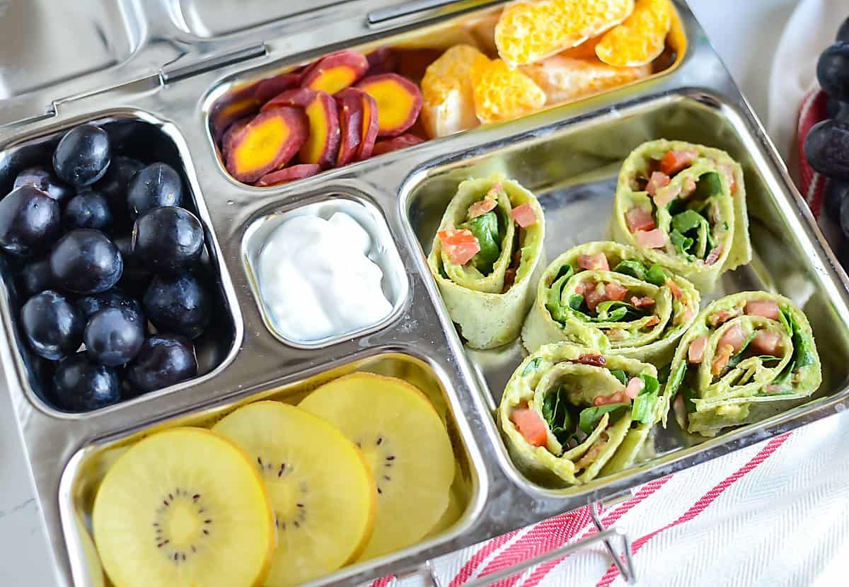Avocado BLT wrap served with fruit and veggies - healthy lunchbox ideas for school