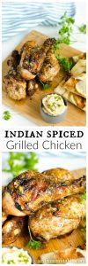 Indian spiced grilled chicken on a cutting board with hummus and naan