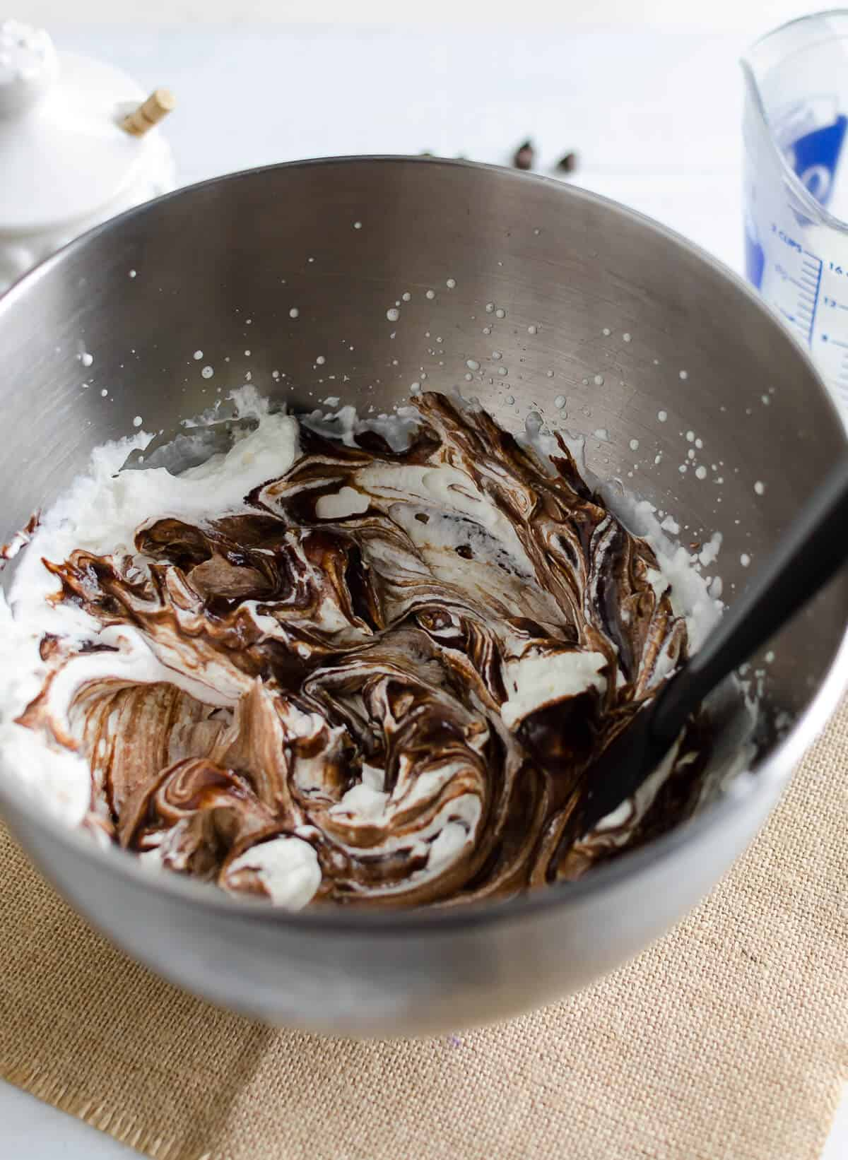 bowl of freshly whipped cream and chocolate mousse lightly stirred with a marble effect