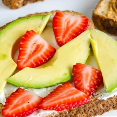 Strawberry Avocado Toast, whole grain toast, cream cheese, sliced avocado and sliced strawberries
