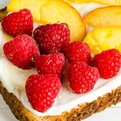 Raspberry Peach Breakfast Toast, whole grain bred, yogurt, honey, fresh raspberries, fresh peach slices