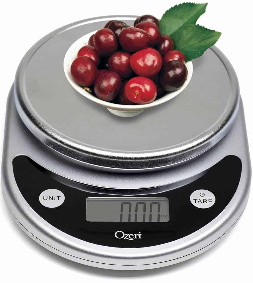 digital food scale with a bowl of cherries on top