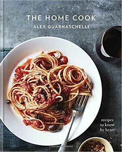 """The Home Cook"" cookbook featuring an image of spaghetti and meat sauce"