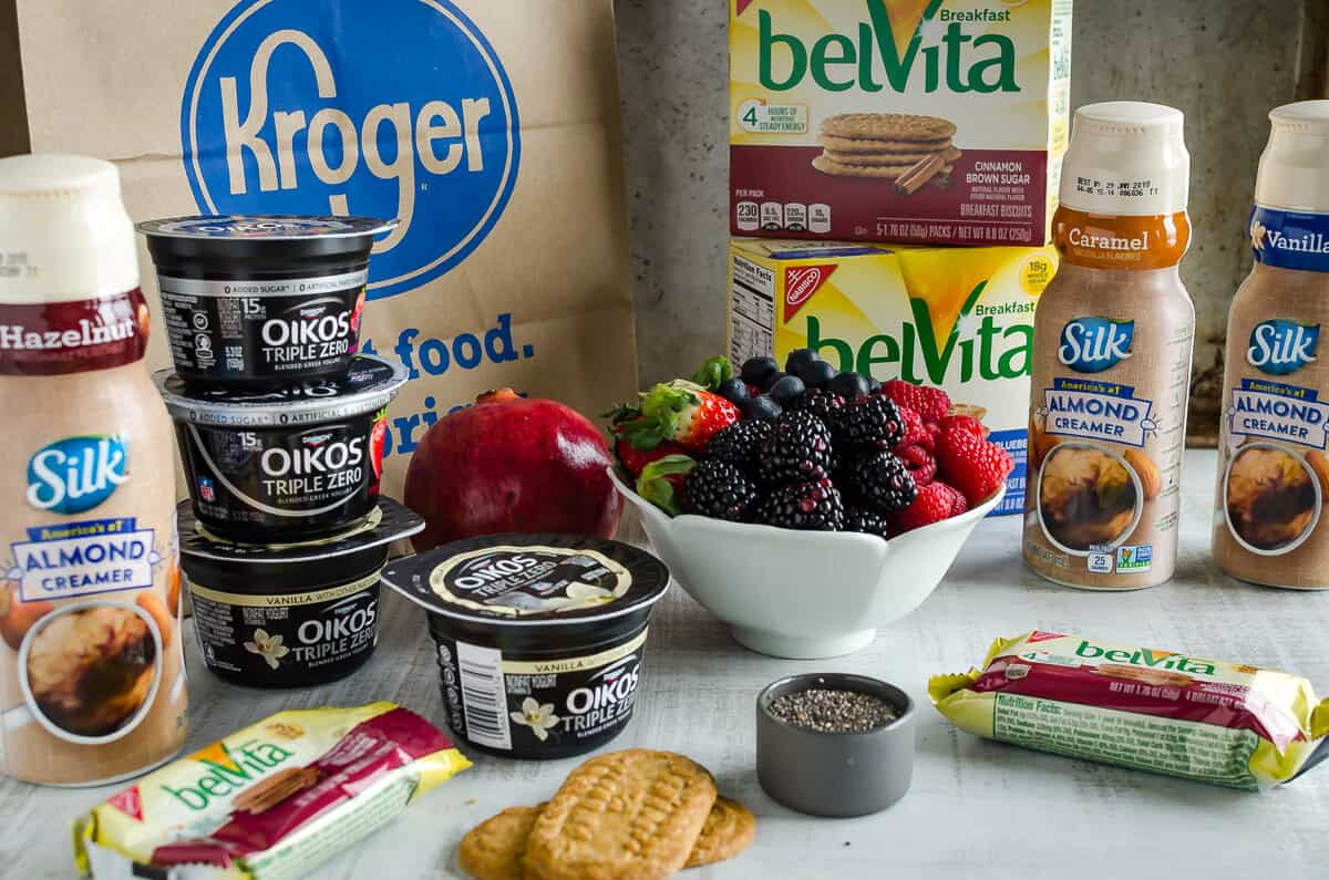 groceries from Kroger to make greek yogurt chia pudding. Oikos Greek yogurt, Pomegranate, Fresh berries, belVita breakfast biscuits, chia seeds