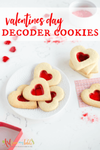 Valentines Day Sugar cookies that reveal messages, heart shaped cookies with a red 'stained glass' window to read a message.