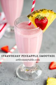 Tall glass full of Strawberry Pineapple Smoothie with hidden veggies.