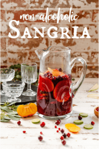 pitcher filled with non alcoholic sangria mocktail and fresh fruit