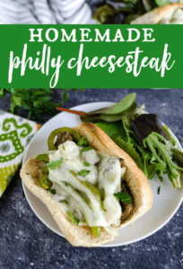 philly cheese steak sandwich with a side salad