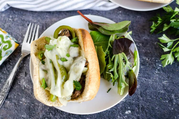 philly cheese steak sandwich smothered in provolone cheese