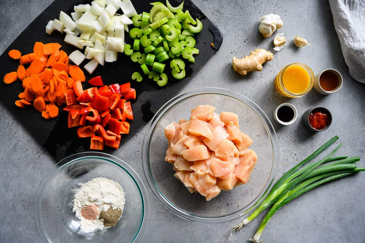 chopped up ingredients for crockpot orange chicken