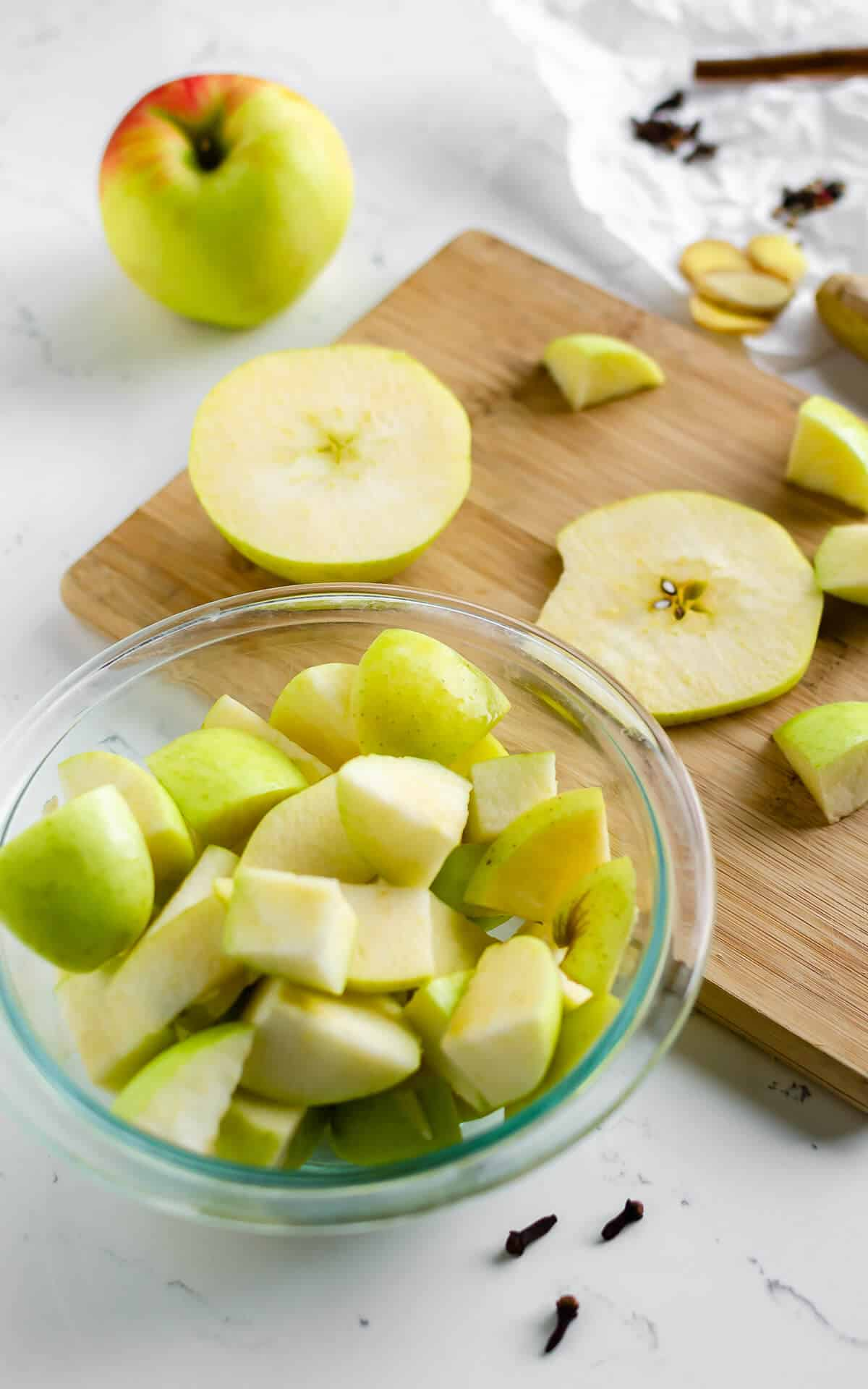 apples cut up into chunks in a large bowl
