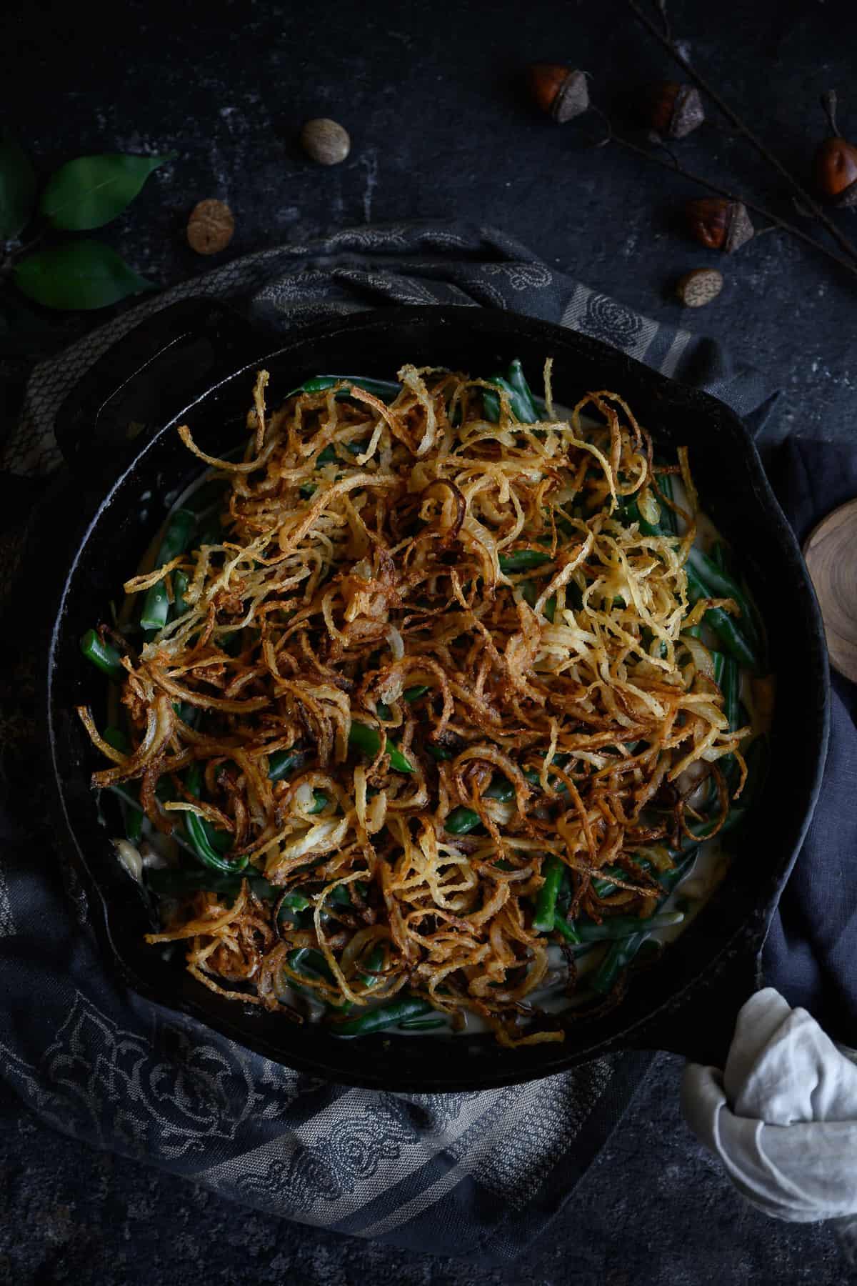 fresh green bean casserole in a cast iron skillet