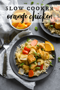slow cooker orange chicken on top of brown rice