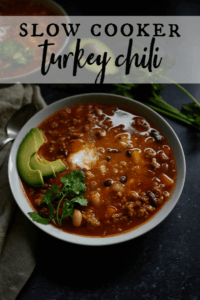 bowl of healthy turkey chili garnished with cilantro and avocado