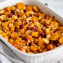 squash apple cranberry bake topped with toasted pine nuts
