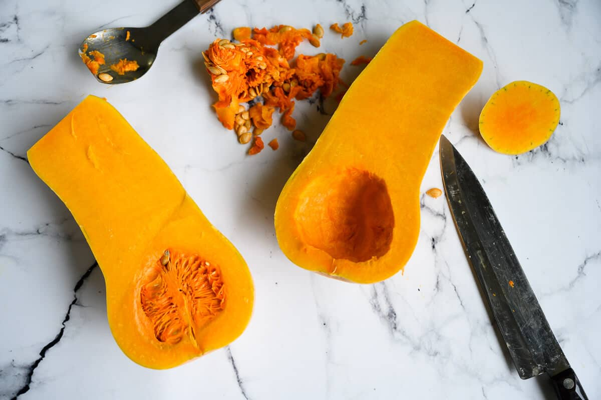 butternut squash cut in half lengthwise with seeds scooped out