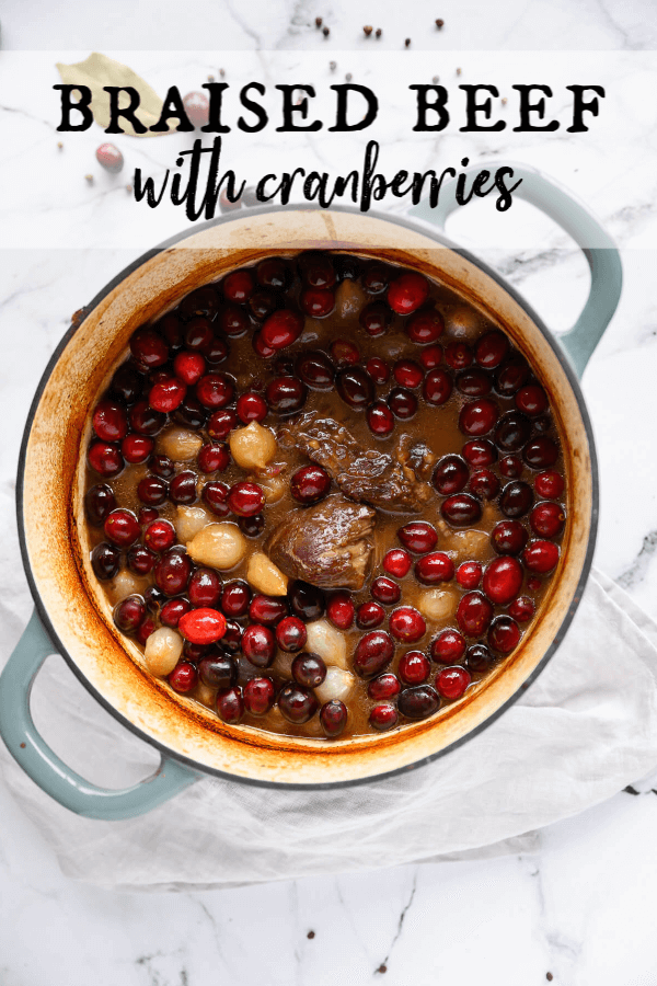 This juicy braised beef recipe is so tender and flavorful! The gravy is infused with red wine, molasses, cranberries, and onions. It's perfect for cold nights or holiday entertaining. The best news, it's super easy to do! #artfrommytable #beef #braisedbeef #christmas #cranberries #easydinneridea #onepotdinner via @artfrommytable