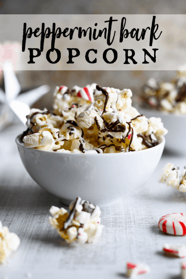 Peppermint Bark Popcorn is an irresistible holiday treat that's quick and easy to make! Crunchy popcorn meets dark and white chocolate and crushed peppermint in this crowd-pleasing snack. #holidaytreats #popcorn #peppermintbark via @artfrommytable
