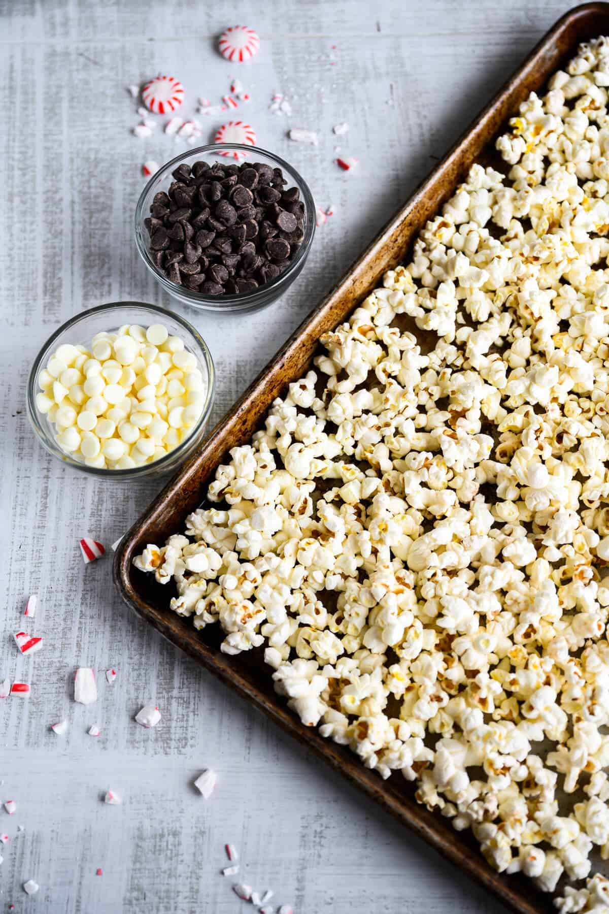 pepprmints, dark and white chocolate chips next to a tray of popcorn
