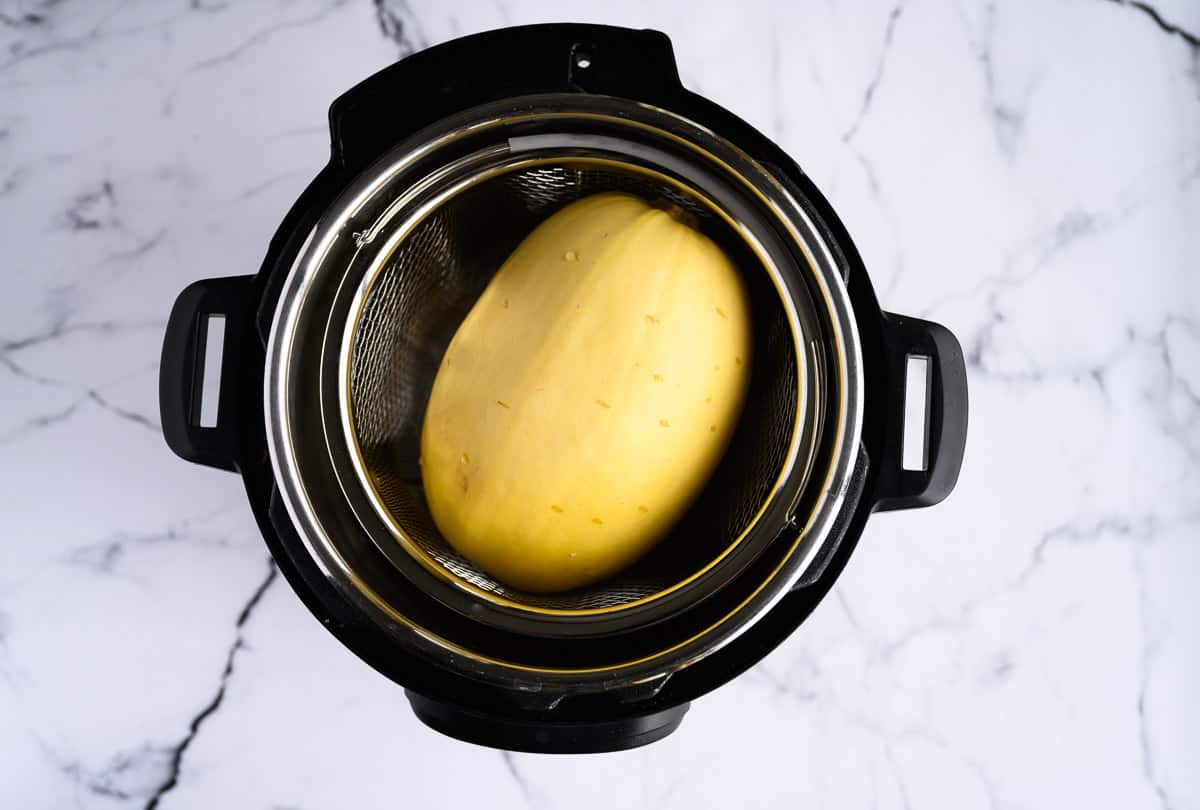 whole spaghetti squash inside an electric pressure cooker