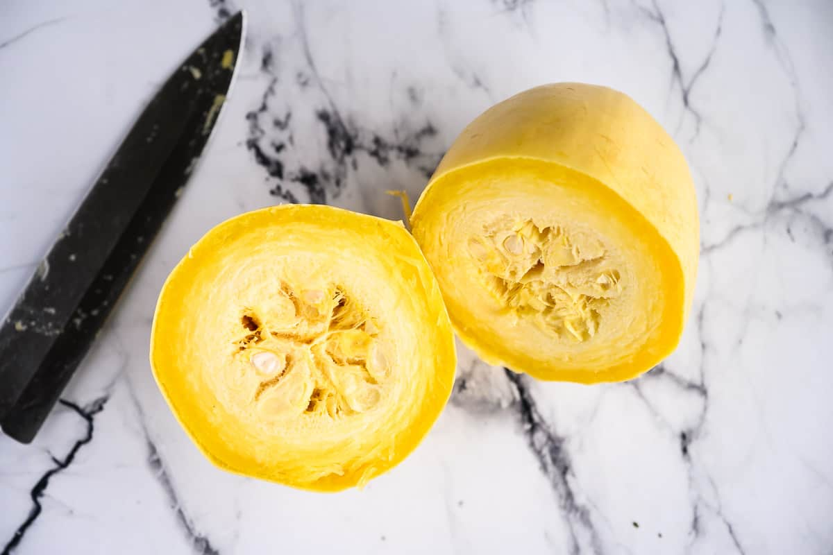 one cooked spaghetti squash split in half, seeds still in tact