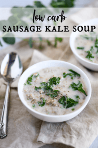 two bowls of sausage kale soup garnished with pepper