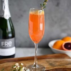 blood orange mimosa mocktail in champagne flute