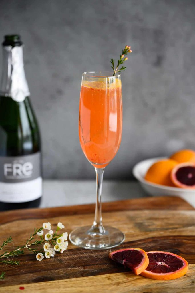 blood orange mimosa mocktail in champagne flute