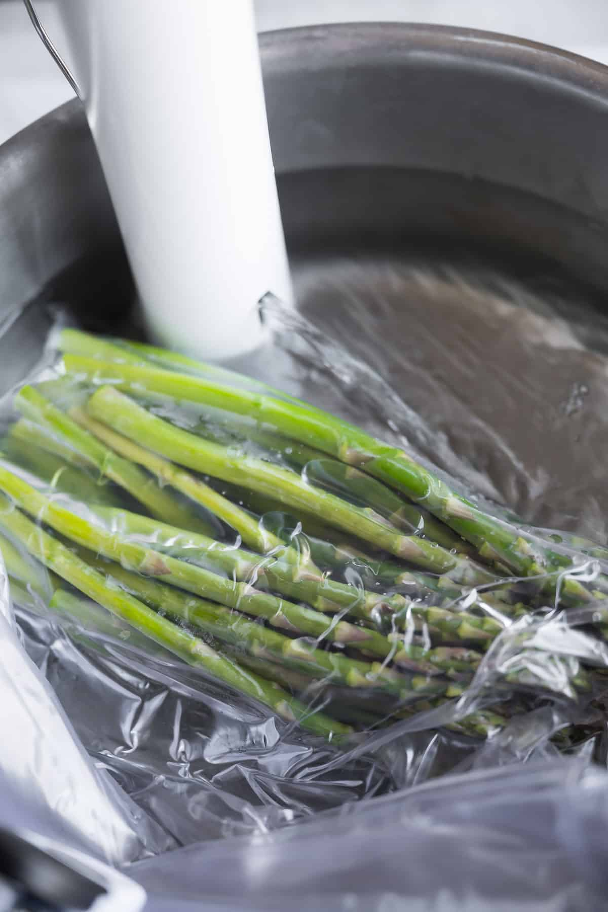 asparagus in a sous vide water bath