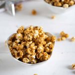 homemade gingerbread caramel corn in a white bowl