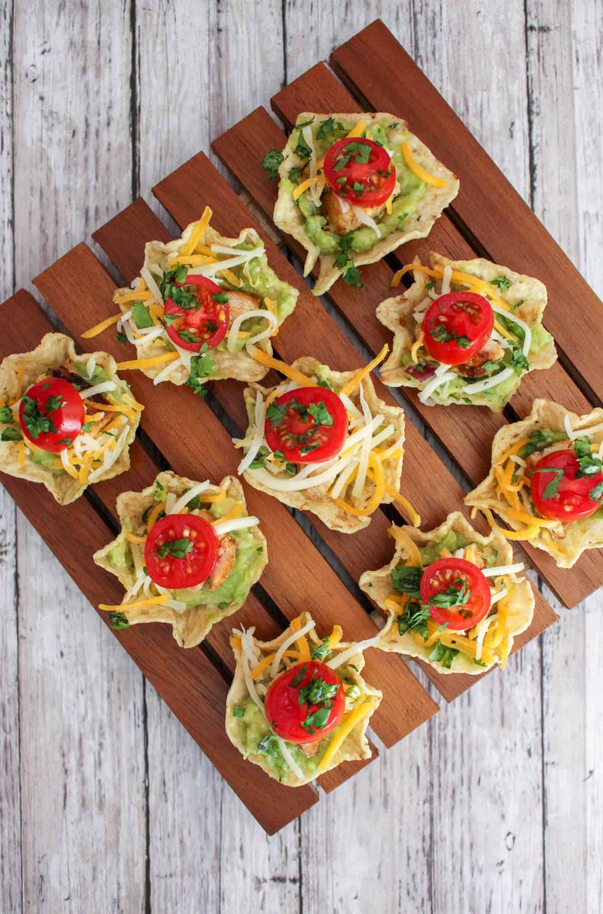 tostito 'scoop' tortilla chips filled with chicken, guacamole, cheese and tomato
