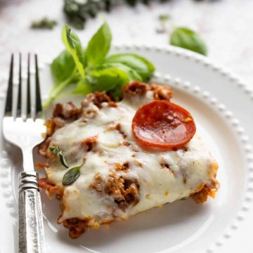 slice of pizza casserole on a white plate