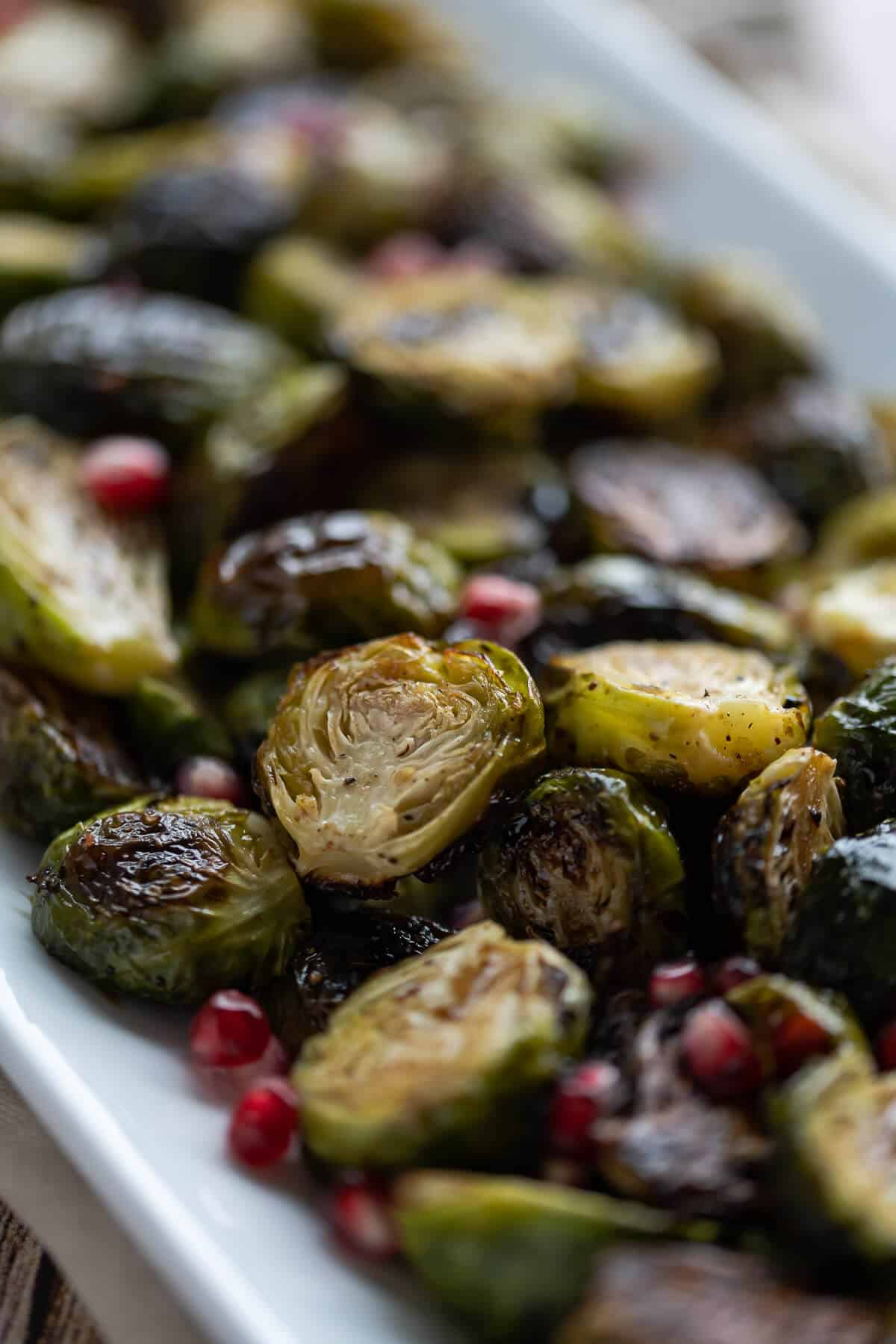 Close up picture of roasted brussels sprouts caramelized on a platter.