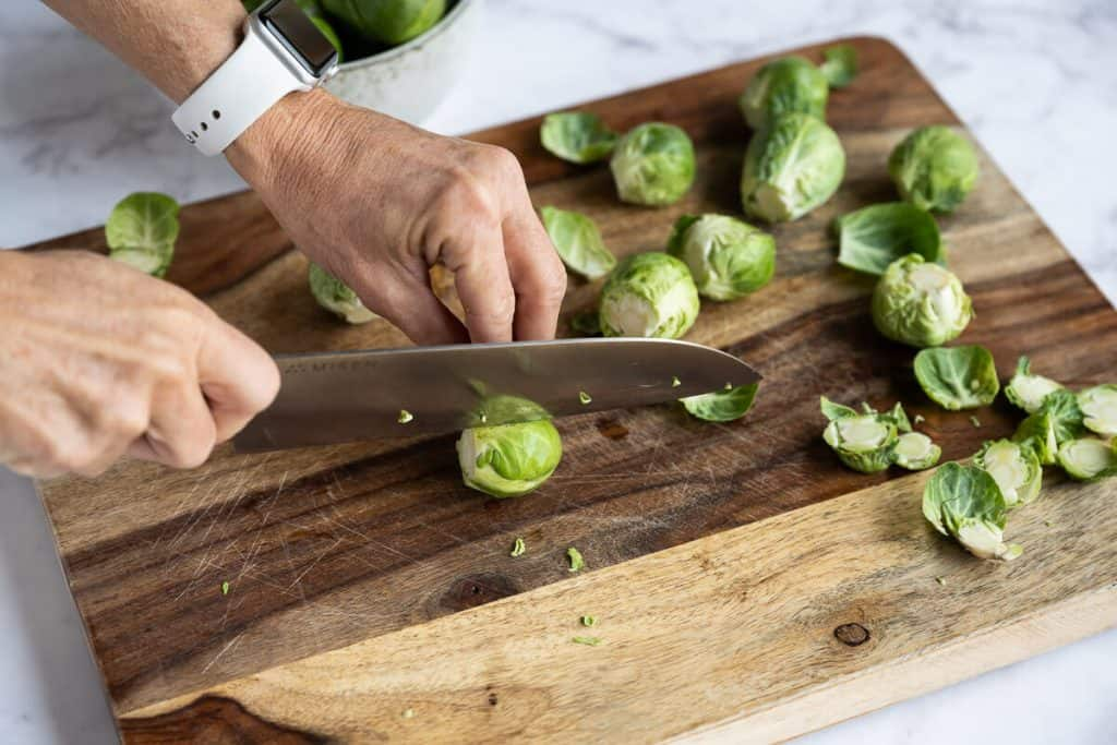 brussels sprout being sliced in half lengthwise