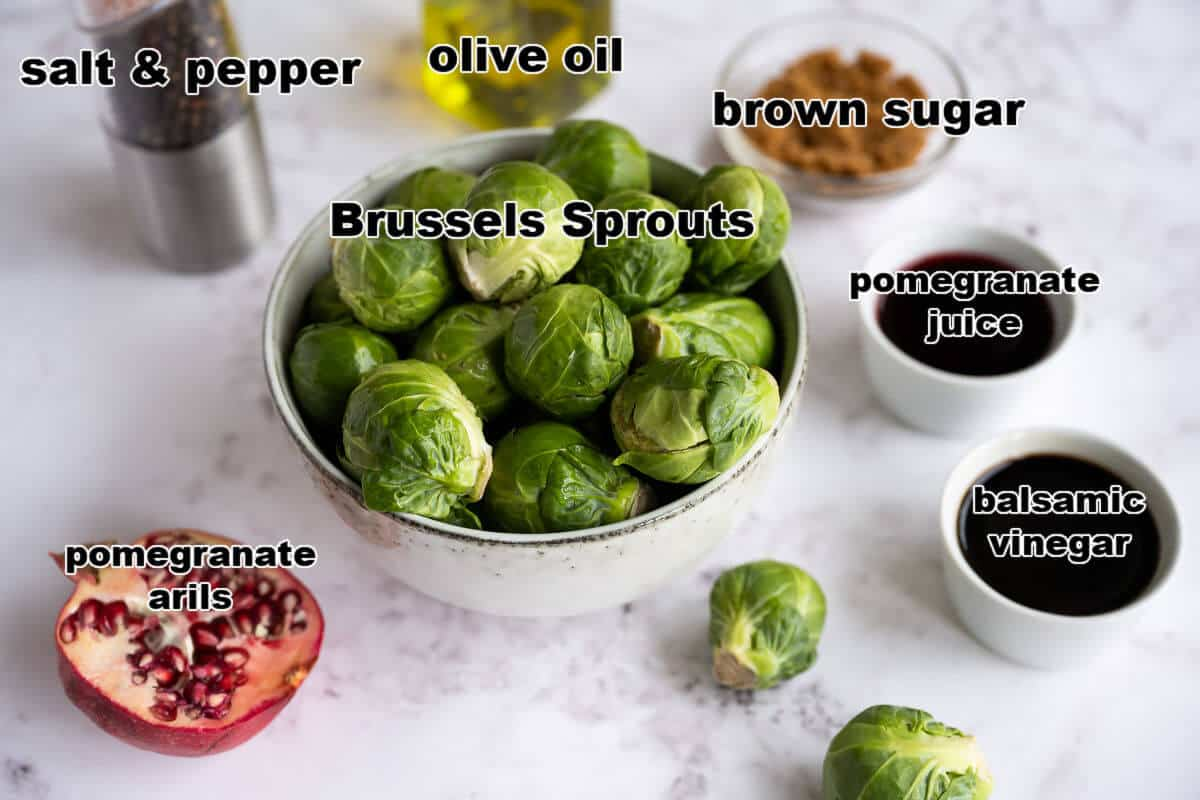 Ingredients for roasted brussels sprouts with pomegranate balsamic reduction: Brussels, olive oil, salt, pepper, brown sugar, pomegranate juice, balsamic vinegar.