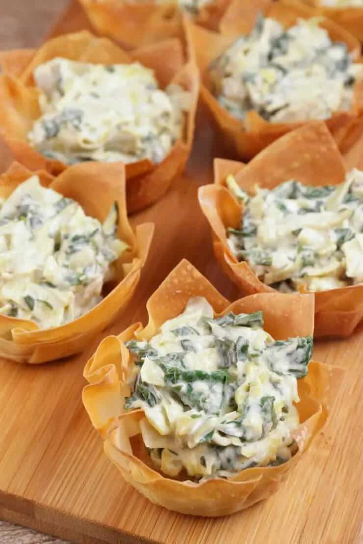 baked wonton cups filled with spinach and artichoke dip