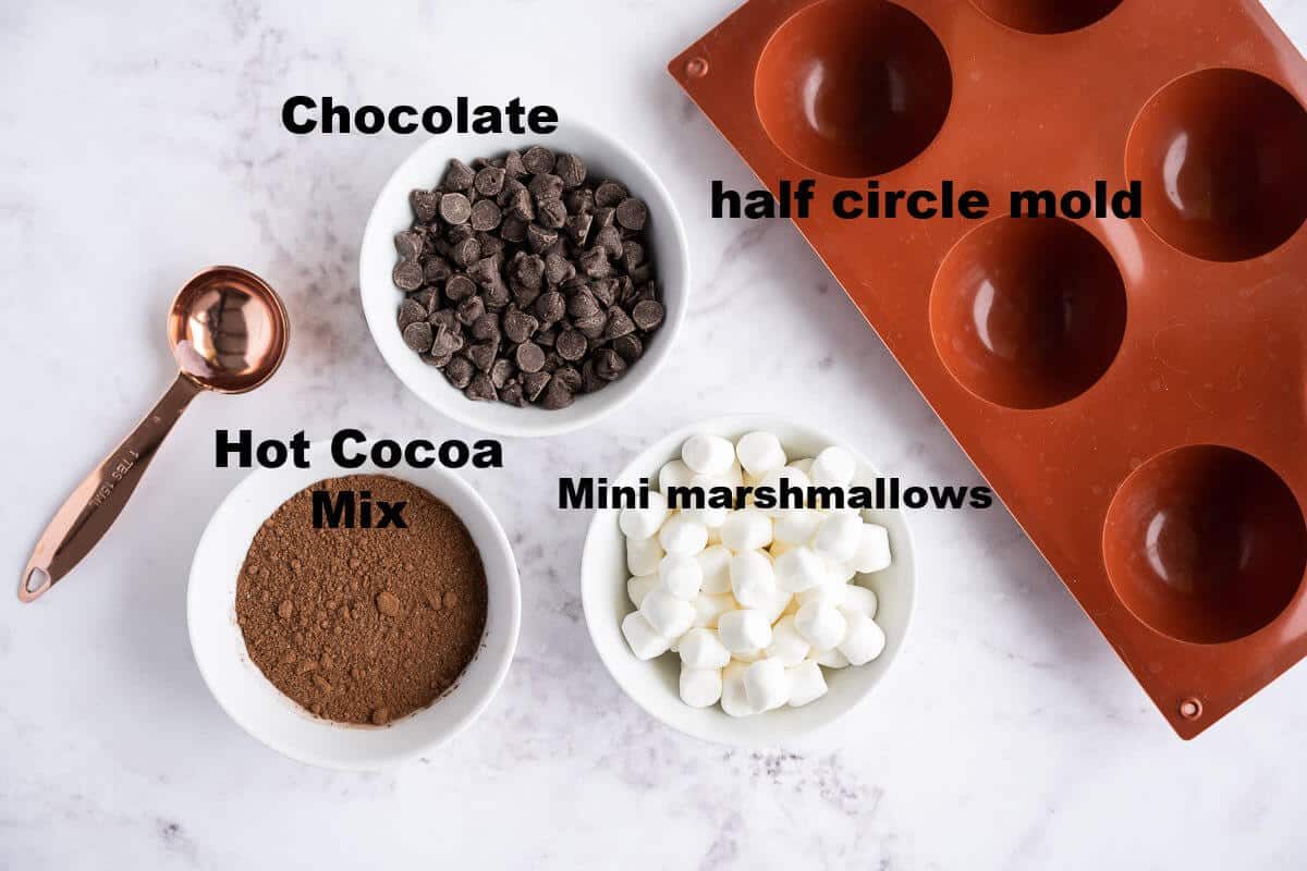 hot cocoa bomb ingredients: chocolate, hot cocoa mix, mini marshmallows, half circle silicone mold