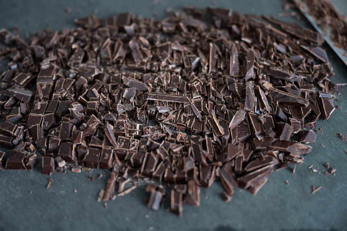 finely chopped dark chocolate on a cutting board